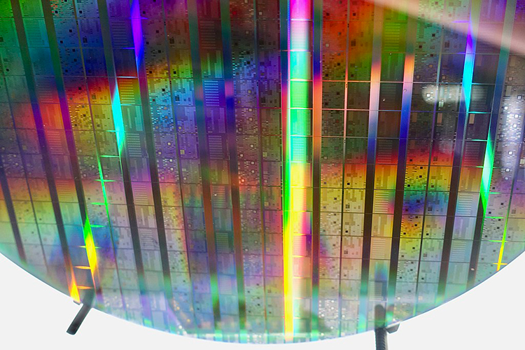 A close-up view of a shiny etched silicon wafer