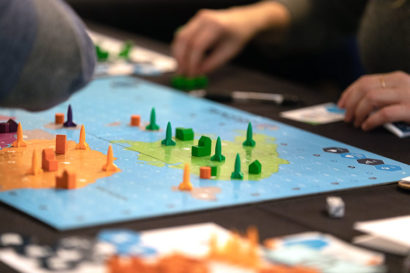 "A close up of the board game ""SIGNAL,"" which looks like a military strategy game"