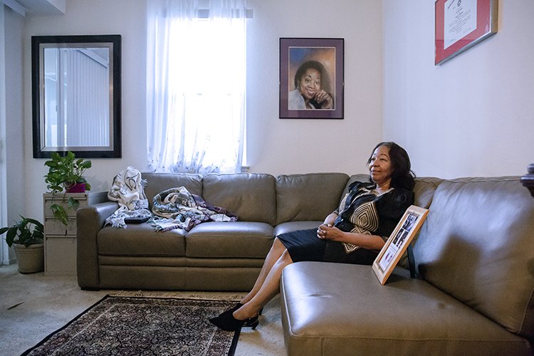 Lorrain Taylor sits in the living room of her home describing the devastating emotional impact of losing her twin sons twin sons, Albade and Obadiah, to a shooting in 2000, when they were 22-year-old college students.