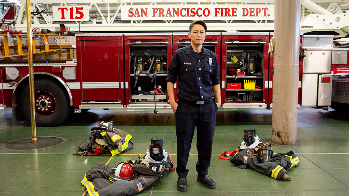 Maiko Bristow, a firefighter and EMT with the San Francisco Fire Department, stands in her firehouse