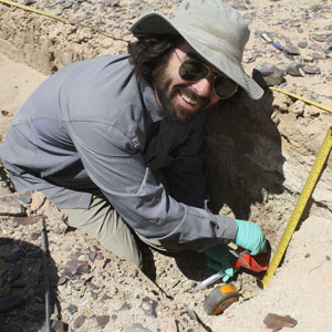 UC Berkeley archaeologist A.J. White digs up sediment in search of ancient fecal stanols.