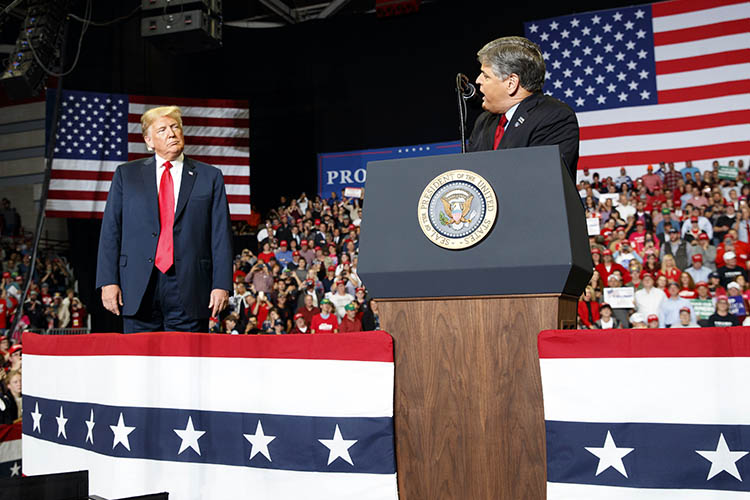 trump and hannity on stage