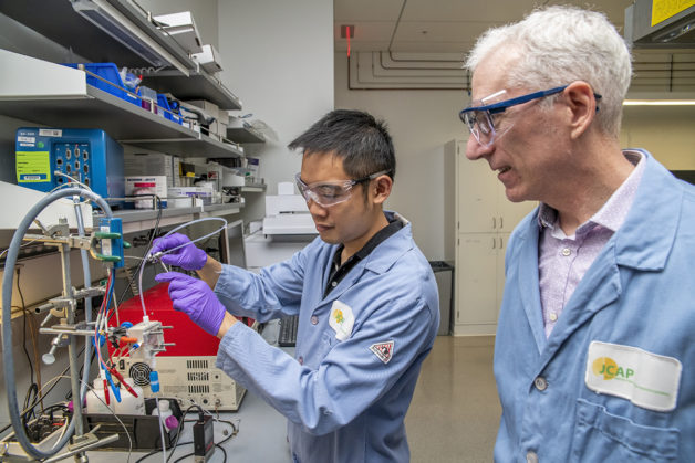 Picture of researchers Yanwei Lum and Joel Ager working on lab equipment
