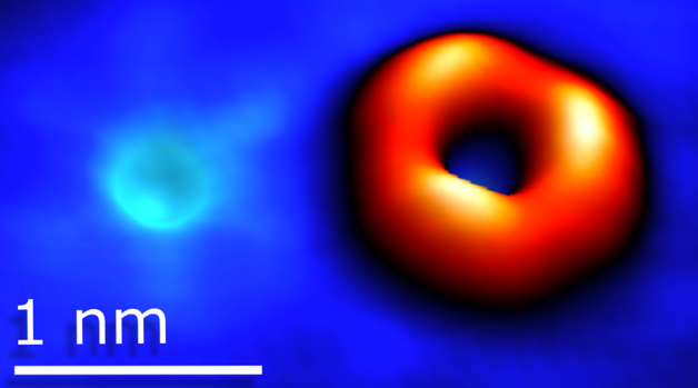 Scanning tunneling microscopy image of an oxygen atom substituting sulfur and a sulfur vacancy in tungsten disulfide.