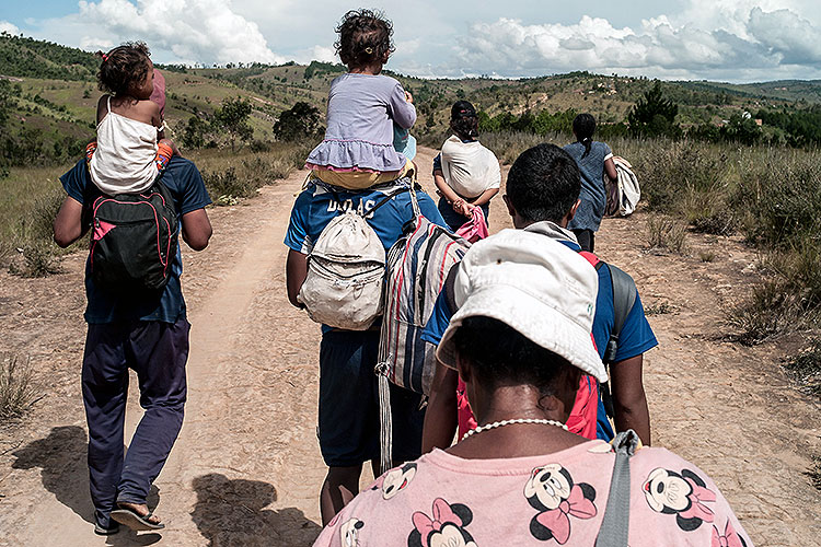 families on foot leaving Antananarivo, the capital of Madagascar