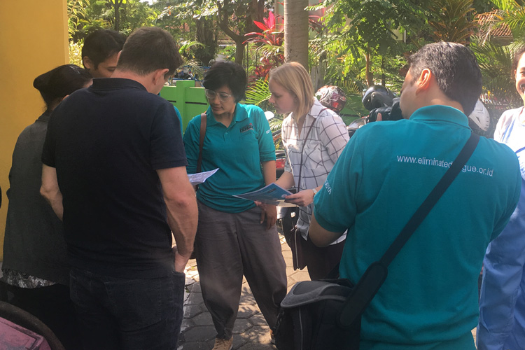 researchers interacting with Indonesian officials during dengue mosquito study