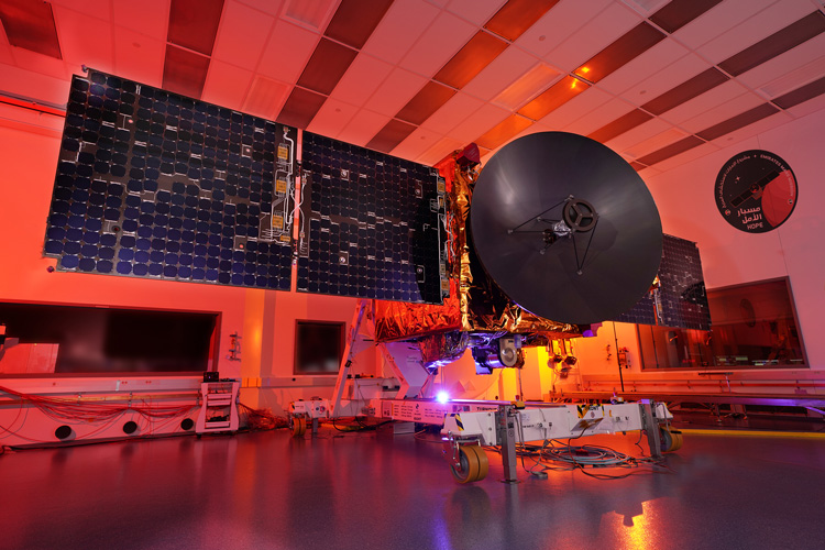 red-lit photo of probe in a testing bay