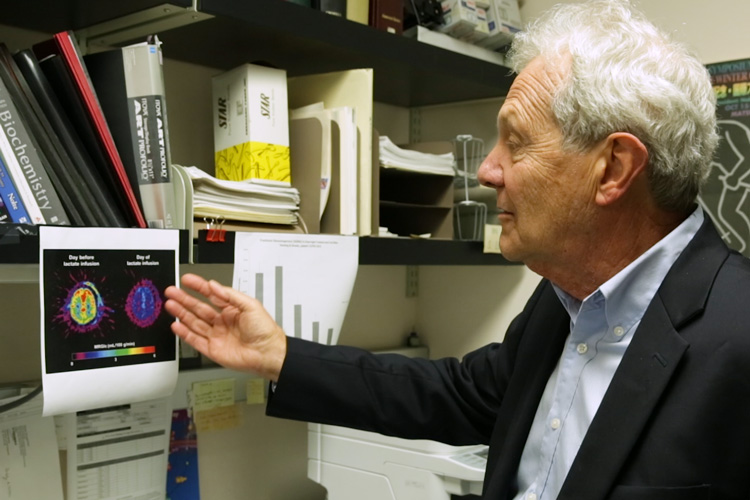 George Brooks looking at image of lactate in the brain.