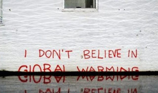 "Message painted on wall ""I don't believe in global warming"""