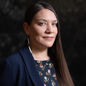 A close-up portrait of Grace Bulltail, an assistant professor at the University of Wisconsin-Madison and a member of the Crow tribe, who benefited from the California Alliance.