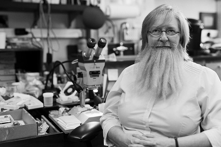 Paleontologist Patricia Holroyd wearing a beard