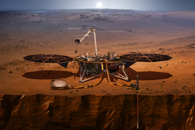 Depiction of the InSight mission lander that is pictured right above a crater on Mars