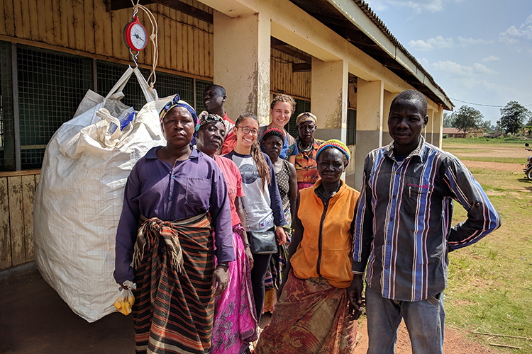 Ugandan women in the village of Gulu pose with a day's worth of plastic bags that they collected for Berkeley Ph.D. candidate Paige Balcom's project.