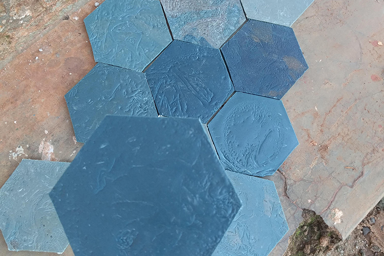 These affordable, customized tiles made at Takataka Plastics came from recycled plastic waste. They are more affordable than ceramic tiles, don't break or chip and can be applied with glue.