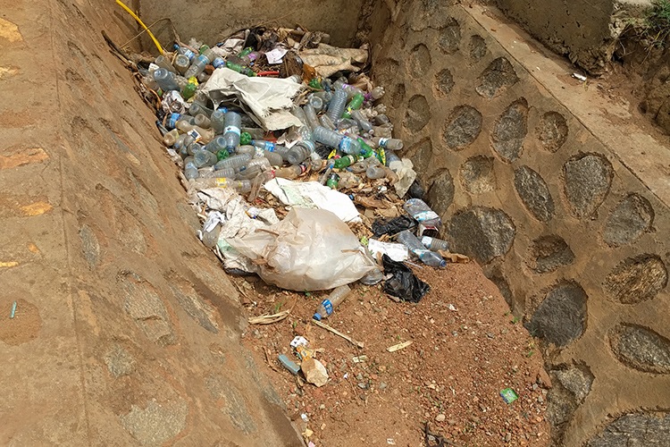 Plastic waste blocks a drain in Gulu, Uganda.