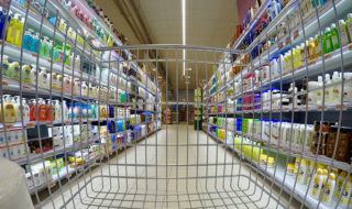 shopping cart among aisle of personal care products
