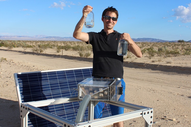 Mathieu Prévot displays water collected by the harvester