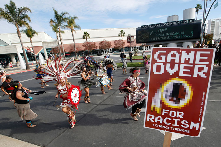 A group protests the Washington Redskins name across from Levi's Stadium before an NFL football game between the Redskins and the San Francisco 49ers.