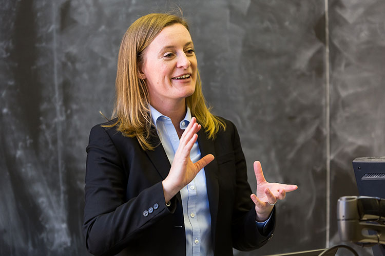 UC Berkeley political scientist Susan D. Hyde lecturing to students