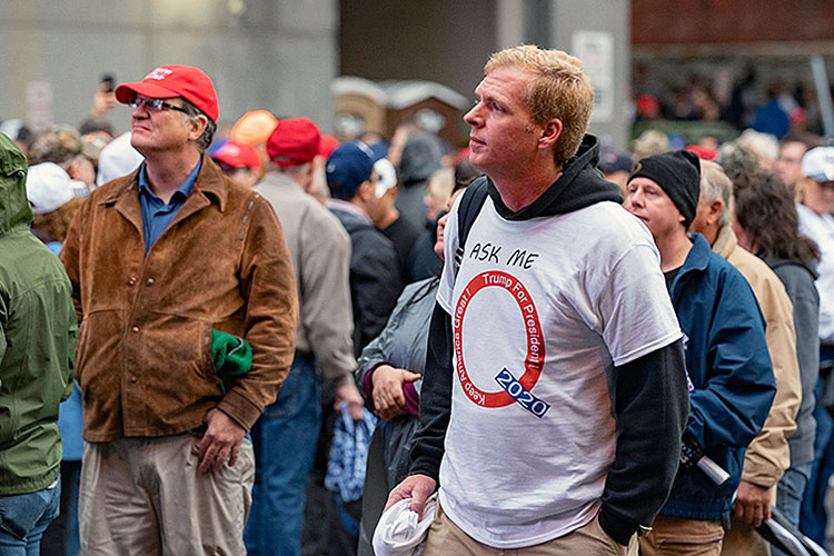 Adherent of the QAnon conspiracy cult awaiting a rally for Donald Trump