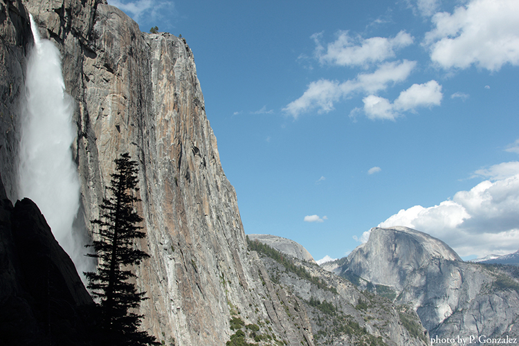 A photo of half-dome and a waterfall in Yosemite National Park