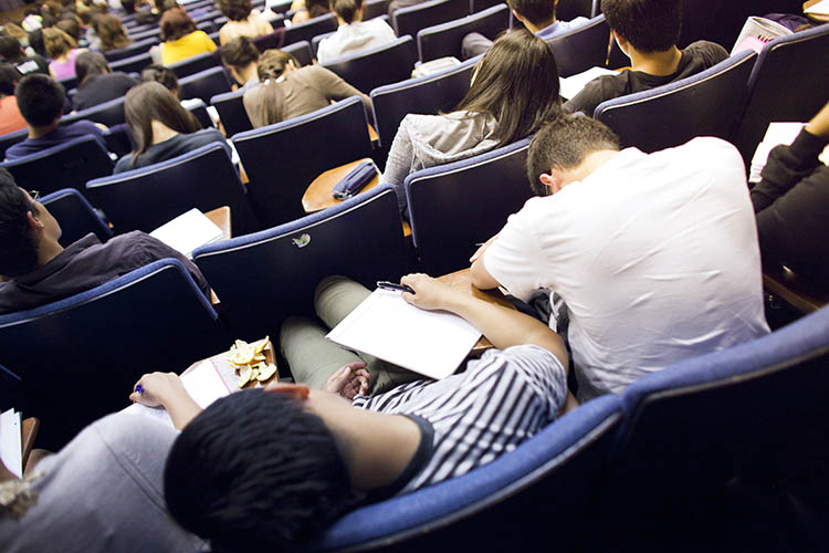 students slumped over in a lecture hall