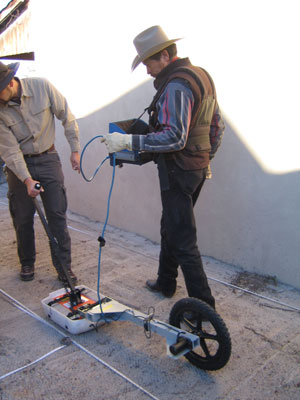 Virgil Trujillo, right, and Jun Sunseri, use a ground-penetrating radar attached to a wheel