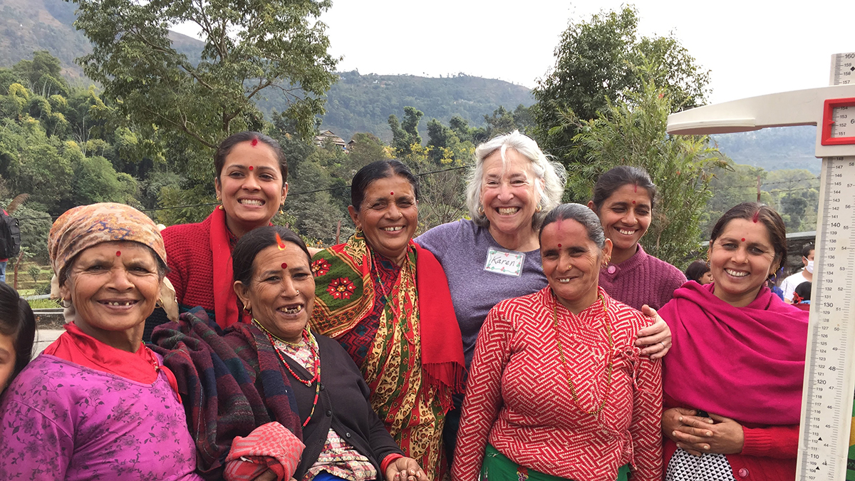 Karen Sokal-Gutierrez with women in rural Nepal