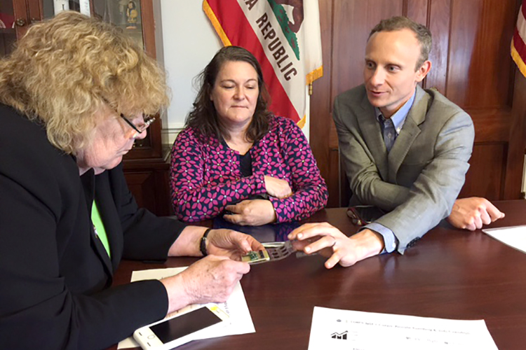 UC Berkeley's Eric Munsing, right, and Rhonda Shrader of the Berkeley-Haas Entrepreneurship Program, center, met with Rep. Zoe Lofgren in May 2017, when Munsing was trying to get his electric-car startup company going. (UC Berkeley photo)