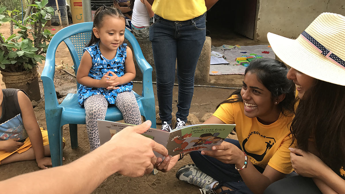 Neha Zahid reading with children
