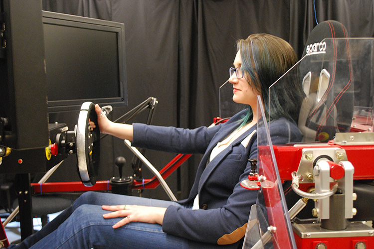 Student Katherine Rose Driggs Campbell in a driving simulator.