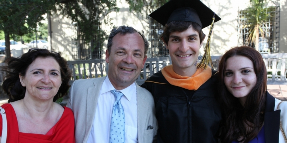 Thibault Duchemin, pictured here at commencement with his family, has designed a mobile app that offers real-time captioning for deaf users. Photo by Aaron Walburg