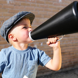 Boy using a megaphone