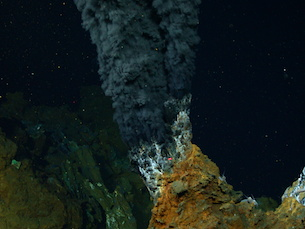 Scientists studying methane-producing microbes, like the ones found in deep-sea hydrothermal vents (pictured here), discovered that a process critical to contemporary photosynthesis likely developed on Earth long before oxygen became available. (Photo by Chris German, courtesy of NOAA Pacific Marine Environmental Laboratory)