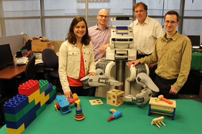 Team photo of UC Berkeley researchers with PR2 robot.
