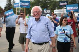 U.S. Sen. Bernie Sanders of Vermont at a Democratic presidential campaign event, surrounded by people carrying Bernie signs
