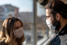 couple wearing masks during coronavirus pandemic