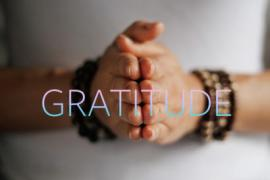 Hands pressed together. Image for Dacher Keltner gratitude video.