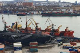 A photo of a port with barges and large shipping containers