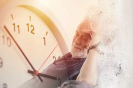 a stock image of an old man with Alzheimer's next to giant clock.