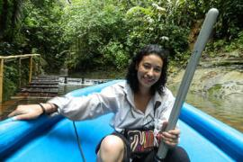 Valeria Ramírez-Castañeda in a boat in the Colombian jungle