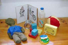 Toys and other items were used in home visits with parents and children in the Jamaican study. Photo by Susan Walker.
