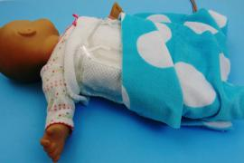 "New wearable electronics will allow an infant to be swaddled in a blanket laced with a network of nearly weightless, printed ""coils"" for more comfortable, less expensive MRI scanning."